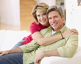 Couple in living room being affectionate