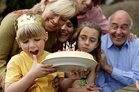Young boy celebrating birthday with family