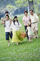 Family outdoors at park with picnic basket
