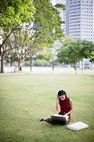 Businesswoman outdoors in park with laptop