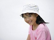 Young girl indoors smiling