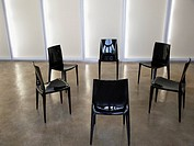 Six empty chairs indoors