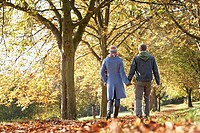 Couple outdoors at a park holding hands