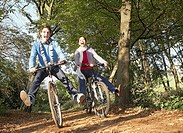 Couple outdoors having fun riding bicycles