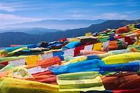 Prayer flags on top of jizu shan mountain, yunnan, China