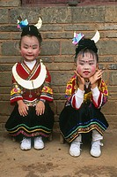Miao children dressed for a show, lusheng festival, gulong, guizhou, China