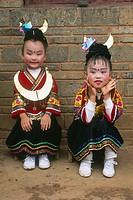 Miao children dressed for a show, lusheng festival, gulong, guizhou, China