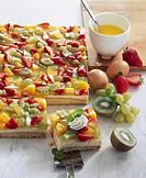 Sponge base topped with blancmange and fruit