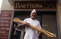 Italian baker with hand-made grissini, Barolo