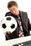 business man with football in office