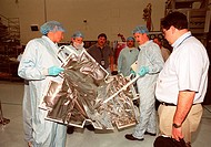03/19/2001 __ At the Space Station Processing Facility, members of the STS_104 crew check out equipment. At left is Mission Specialist Michael L. Gern...