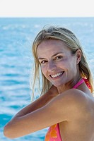 Woman in bikini smiling at camera