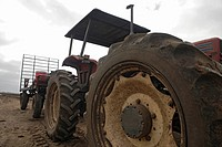 View of two tractor parked on a field