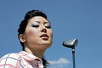 Portrait of a young woman with a golf club (thumbnail)
