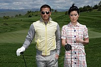 View of a couple standing on a golf course