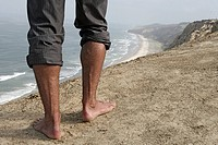 View of a persons barefoot on cliff