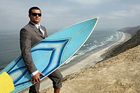 View of a man holding a surfboard