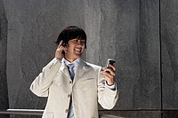 Portrait of an executive using a cellphone