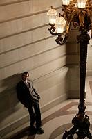 View of a businessman near a wall