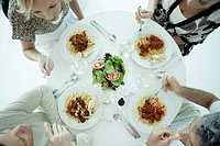 Aerial view of four people eating