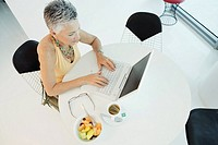 Mature woman working on a laptop