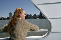 Back view of a young woman on a boat