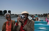 Passengers on board a boat taking pictures