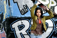 View of a young woman near a graffiti
