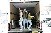 View of three people dancing in a van
