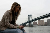 View of young woman with its cell phone