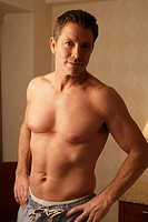 Mature man looking at camera shirtless
