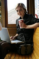 Mature business woman on a wood bench