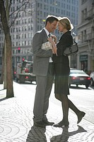 Couple standing in the street together