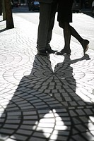 Shadow of two people on the street