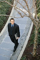 Business man walking on a path