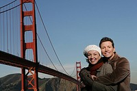 Couple embracing near the Golden Gate Bridge