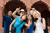 Close-up of a group of friends standing together, Taj Mahal, Agra, Uttar Pradesh, India