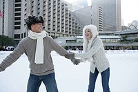 Mature couple ice skating