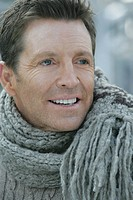 Close-up of mature man wearing a scarf