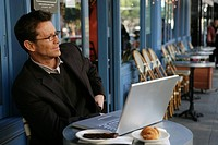 Mature busines man at a cafe (thumbnail)