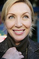 Close-up of mature woman smiling