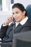 Businesswoman talking on the telephone in an office