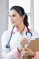 Close-up of a female doctor standing with a stethoscope around her neck