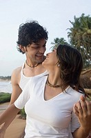 Young couple romancing on the beach, Goa, India