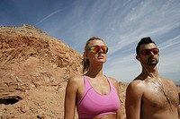 Two people wearing shades outdoors