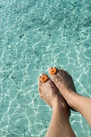 Man feet at Indian Ocean, Maldives