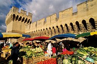 The open air market along the city walls. Avignon city. Vaucluse departement. Provence. France.