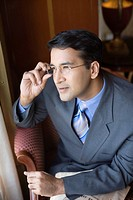 Businessman adjusting his eyeglasses