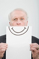 A businessman holding a smiley face