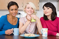 Three female friends in kitchen